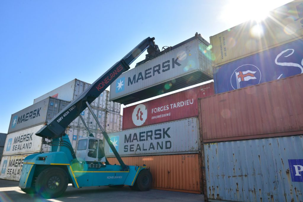 Loading containers with crane